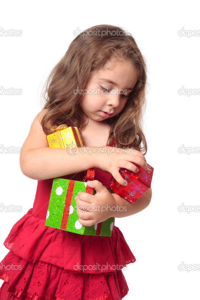 Little girl holding some Christmas presents in her arms. — Stock Photo #2808435