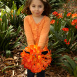 Girll with bunch of clivia from garden — Stock Photo