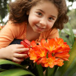 Little girl garden of clivia miniata — Stock Photo