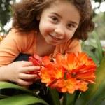 Little girl garden of clivia miniata — Stock Photo