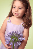 Sweet girl with lily flower — Stock Photo
