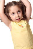 Toddler girl arms above head — Stock Photo