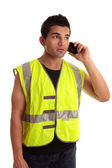 Builder tradesman takes a call — Stock Photo