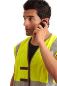 Tradesman handyman on the phone — Stock Photo
