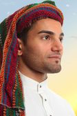 Arab man looks out expectantly — Stock Photo
