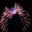 Stock Photo: Blue and red fireworks
