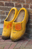Yellow wooden shoes — Stock Photo