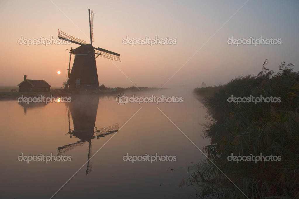 A dutch windmill at sun-rise — Stock Photo #2811659