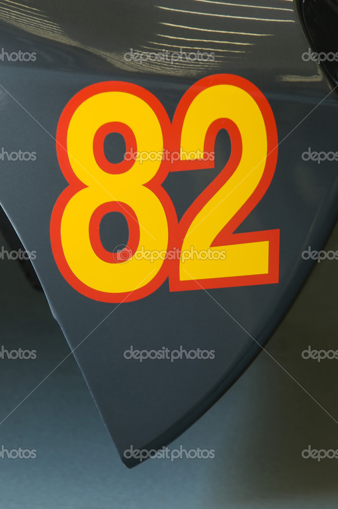 A yellow number 82 on a racecar — Stock Photo #2859603