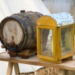 Candle-holder and wine barrel — Stockfoto