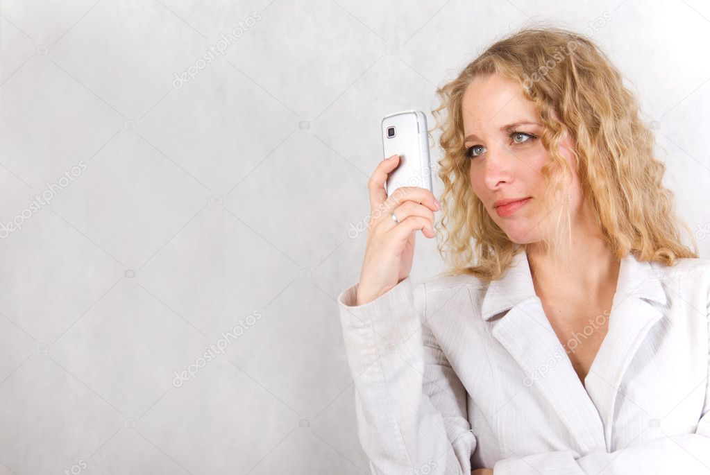 The girl speaks on a cellular telephone.  Stock Photo #2942388