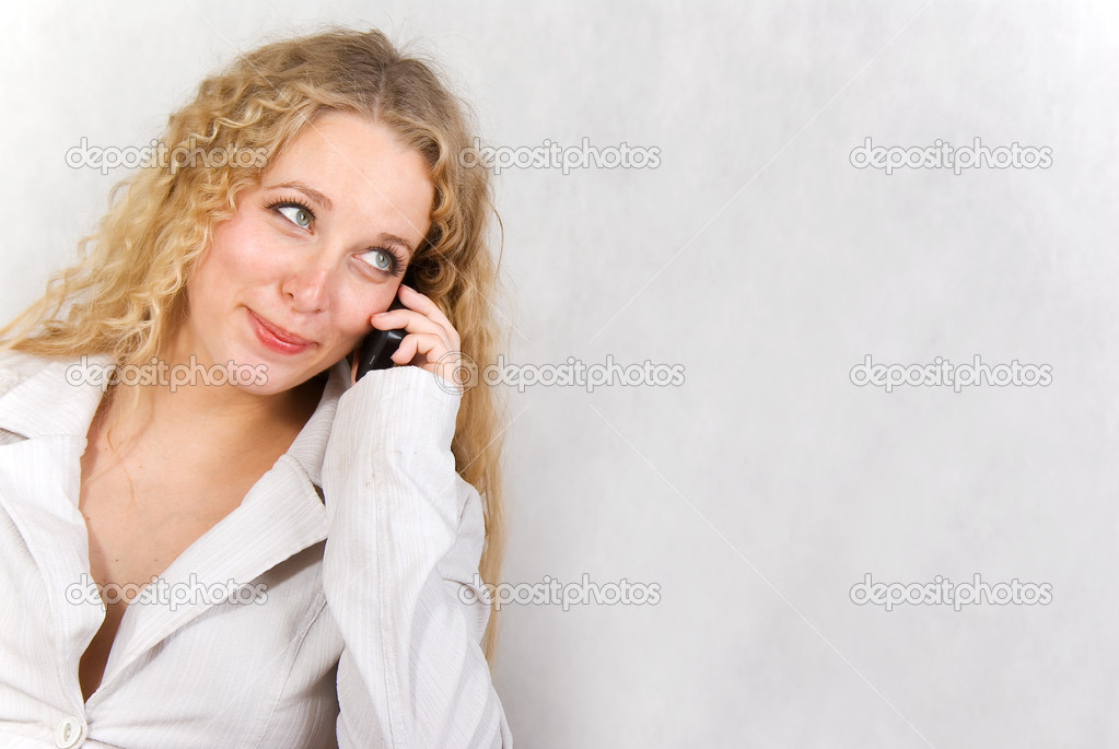 The girl speaks on a cellular telephone. — Stock Photo #2942421