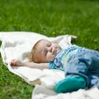 Little boy sleeping on a grass in summer — Stock Photo