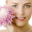 Beautiful woman with flower isolated — Stock Photo