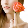 Young beautiful woman with rose isolated — Stock Photo