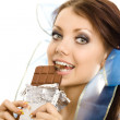 Pigtails girl eat chocolate closeup — Stock Photo