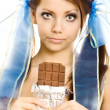 Stock Photo: Pigtails girl with chocolate isolated