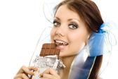 Pigtails girl eat chocolate closeup — Stock Photo
