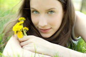 Young beautiful teenager with dandelion — Stock Photo