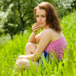 Stock Photo: Young beautiful woman reverie in grass
