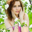 Beautiful sensuality woman in blossom orchard — Stock Photo #3287678