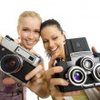 Two woman have fun with camera isolated — 图库照片