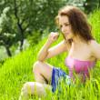Young beautiful woman reverie in grass — Stock Photo