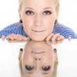 Woman reflection mirror smile white background — Stock Photo
