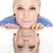 Woman reflection mirror smile white background — Stock Photo #3288100