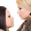 Two woman isolated fur black blond close eye makeup — Stock Photo