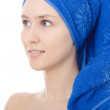 Woman with towel on head blue isolated smile — Stock Photo
