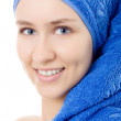 Woman with towel on head blue isolated smile — Stock Photo #3288187