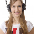 Headphones girl smile on white background - Stock Photo