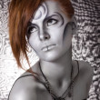 Portrait body art red girl silver — Stock Photo