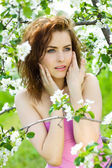 Beautiful sensuality woman in blossom orchard — Stock Photo