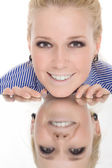 Woman reflection mirror smile isolated — Stock Photo