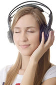 Headphones girl dream close eye — Stock Photo