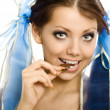 Stock Photo: Pigtails girl with chocolate enjoy closeup isolated
