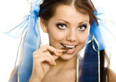 Pigtails girl with chocolate enjoy closeup isolated — Stock Photo