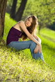 Beautiful teen girl in forest — Stock Photo