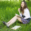 Young schoolgirl in park read book — Stock Photo #3368667