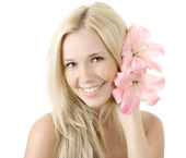Beautiful young blonde woman with lily flower smile isolated — Stock Photo