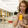 Portrait of a beautiful young woman with a glass of juice in sh — Stock Photo