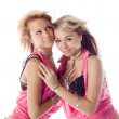 Portrait of two attractive dancers in pink costumes isolated — Stock Photo