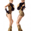 Two beautiful dancer girl in gold costumes isolated — Stock Photo #3396499