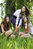 Three pretty student girls with books outdoor — Stockfoto