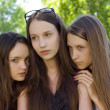 Three  despondent student girl outdoor - Stock Photo