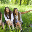 Three beautiful student girls spend time in the park — Stock Photo #3411176
