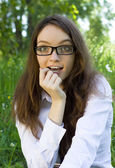 Beautiful student girl in the park — Stock Photo