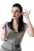 Portrait of pretty young pin-up woman applying mascara using las — Stock Photo